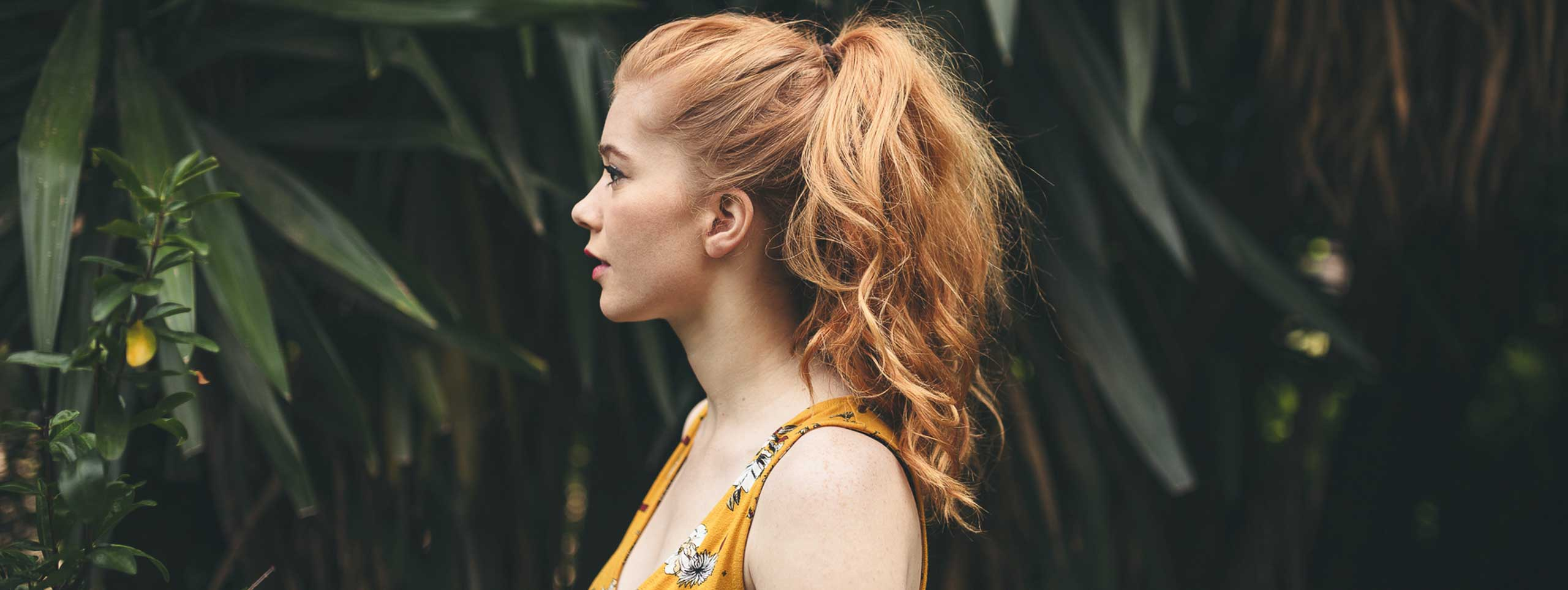 Young Redhead Woman With A Ponytail